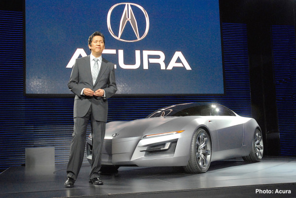 "Detroit - January 7, 2007 -- Jon Ikeda, principal designer, Acura Design Center unveils the Acura ""Advanced Sports Car Concept"" today at the 2007 North American International Auto Show in Detroit. The concept's exterior demonstrates a dynamic fusion of advanced technology and emotion. The long, pronounced hood features deeply sculpted lines and embossed air vents, both of which hint at the powerful engine beneath. The exterior lines run the length of the body, creating a ribbon-like effect from the front headlights to the rear wheel arches, evoking a feeling of movement and power. For more information go to www.acuranews.com."